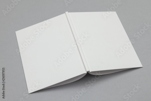 Hardback book mockup. White book on a grey background Fototapet