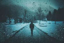 Blurry Lonely Man Walks On Mis...