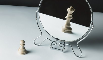 Chess Pawn Looking in the Mirror