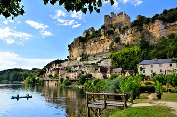 View of the beautiful village of Beynac et Cazenac with river reflections Dordogne, France