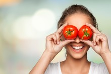 Beautiful Laughing Woman Holding Two Ripe Tomatoes