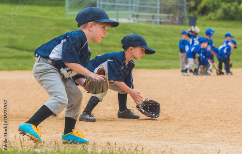 Youth Baseball Players Fielding Ground Balls