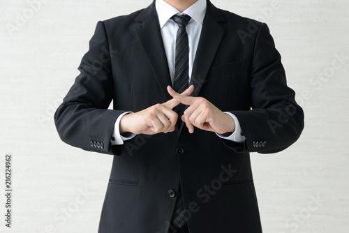 バツ印をつくるビジネスマン Fototapet