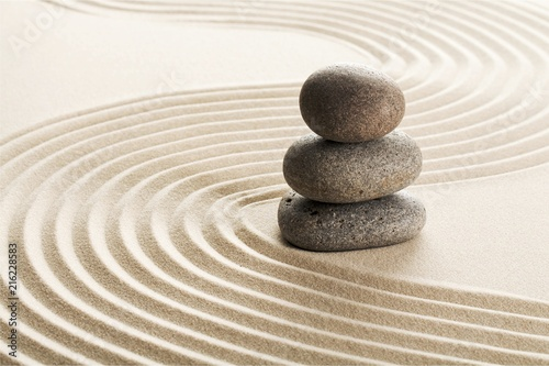 Photo Stands Stones in Sand Zen stones in the sand. Grey background