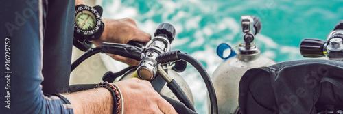 Diver prepares his equipment for diving in the sea BANNER, long format Wallpaper Mural