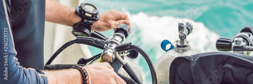 Photo Diver prepares his equipment for diving in the sea BANNER, long format