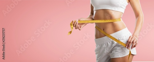 Woman with measure. Fototapeta