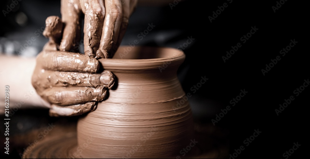 Fototapety, obrazy: Hands of potter making clay pot