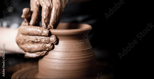 Hands of potter making clay pot Canvas