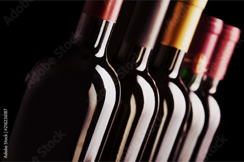 Dark wine bottles in row