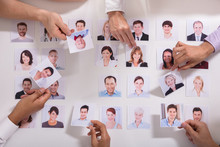 Group Of Businesspeople Selecting Candidate Photo