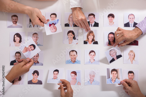 Fototapeta Group Of Businesspeople Selecting Candidate Photo obraz
