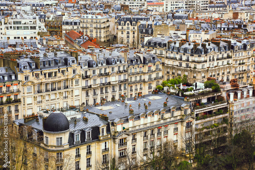 Papiers peints Paris Aerial view of cityscape, old town, historical streets, typical parisian rooftops, traditional facades of old french houses, exterior of buildings. Top of city from Eiffel Tower in Paris, France.