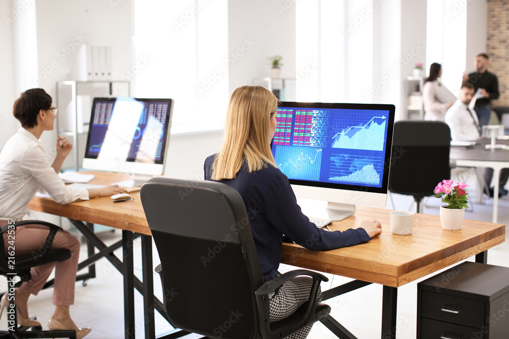 Fototapeta Woman working with stock data in office. Finance trading