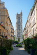 Paris typical street and Saint-Jacques flamboyant gothic tower
