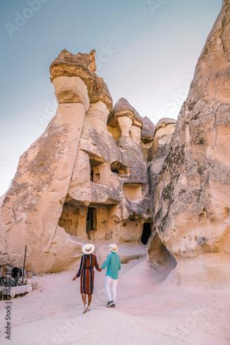 happy young couple on vacation in Turkey Cappadocia, Rock Formations in Pasabag Monks Valley, Cappadocia, Turkey Wall mural