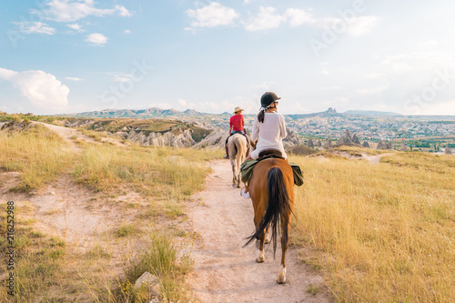 Fotografie, Tablou horse riding Cappadocia, woman horse riding Kapadokya Turkey