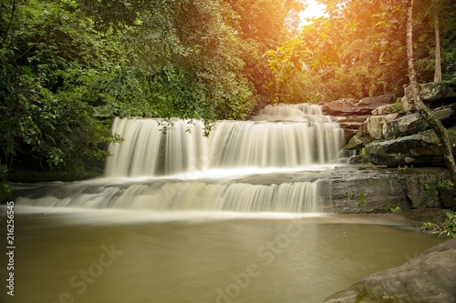 Fotobehang Bos rivier Than Thong Waterfall in Nong Khai Province, Thailand./Than Thong Waterfall in Nong Khai Province, Thailand.It is a popular place to relax with family during the weekend.(Add orange light to the beauty