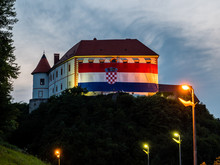 Ozalj Castle With Big Croatian Flag Over Its Front Side To Celebrate Croatia Winning Second Place In World Cup 2018 In Moscow, River Dobra, Karlovac County, Croatia