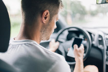 Careless Driver Using A Mobile Phone Whilst Driving