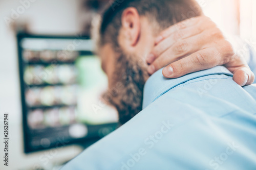 Stampa su Tela Office worker with neck pain from sitting at desk all day
