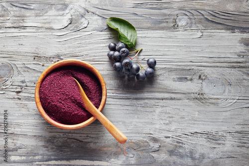 Aronia powder in a bowl