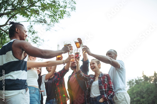 Fototapety, obrazy: Group of friends making barbecue in the backyard. concept about good and positive mood with friends