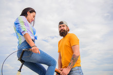 Why Women More Attracted Biker Guys. Girl Sit On Handlebar Of His Bike. Man Bearded Hipster Rides Girlfriend On His Bike. Women Pay Attention To Bikers. Girl Likes He Rides Her On Handlebar