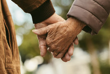 Elderly Couple Holding Hands A...