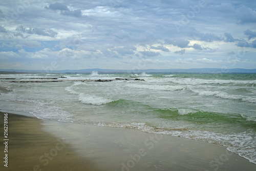 Sandy beach in bad weather with big waves 3 - Buy this stock