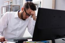 Stressed Businessman Sitting I...
