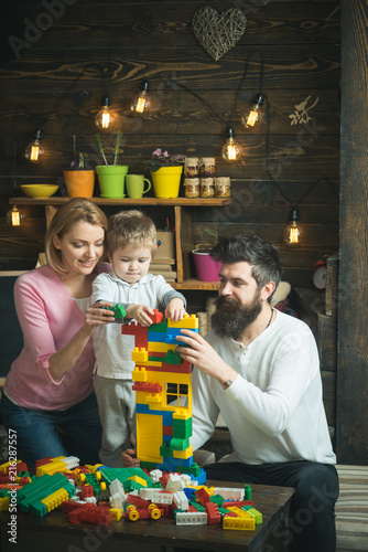 Childhood concept. Child and family play with toy bricks, childhood. Early childhood development. Early childhood education