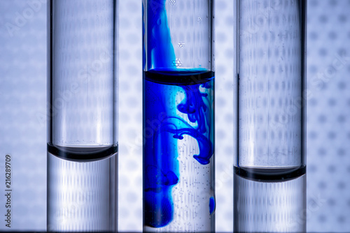 Vászonkép Closeup liquid of blue color ink in water in a test tube of vitro