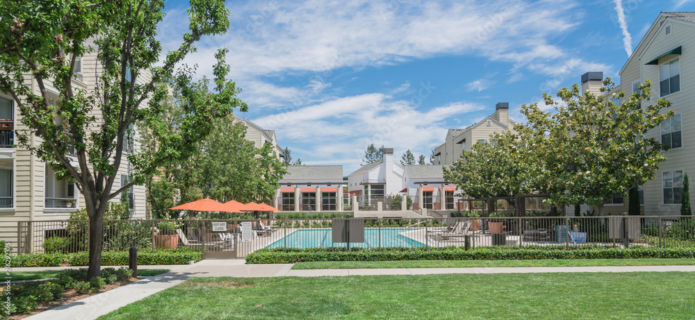 Fototapety, obrazy: Common apartment building complex in Palo Alto, California, USA with fenced guard swimming pool. Summer cloud blue sky