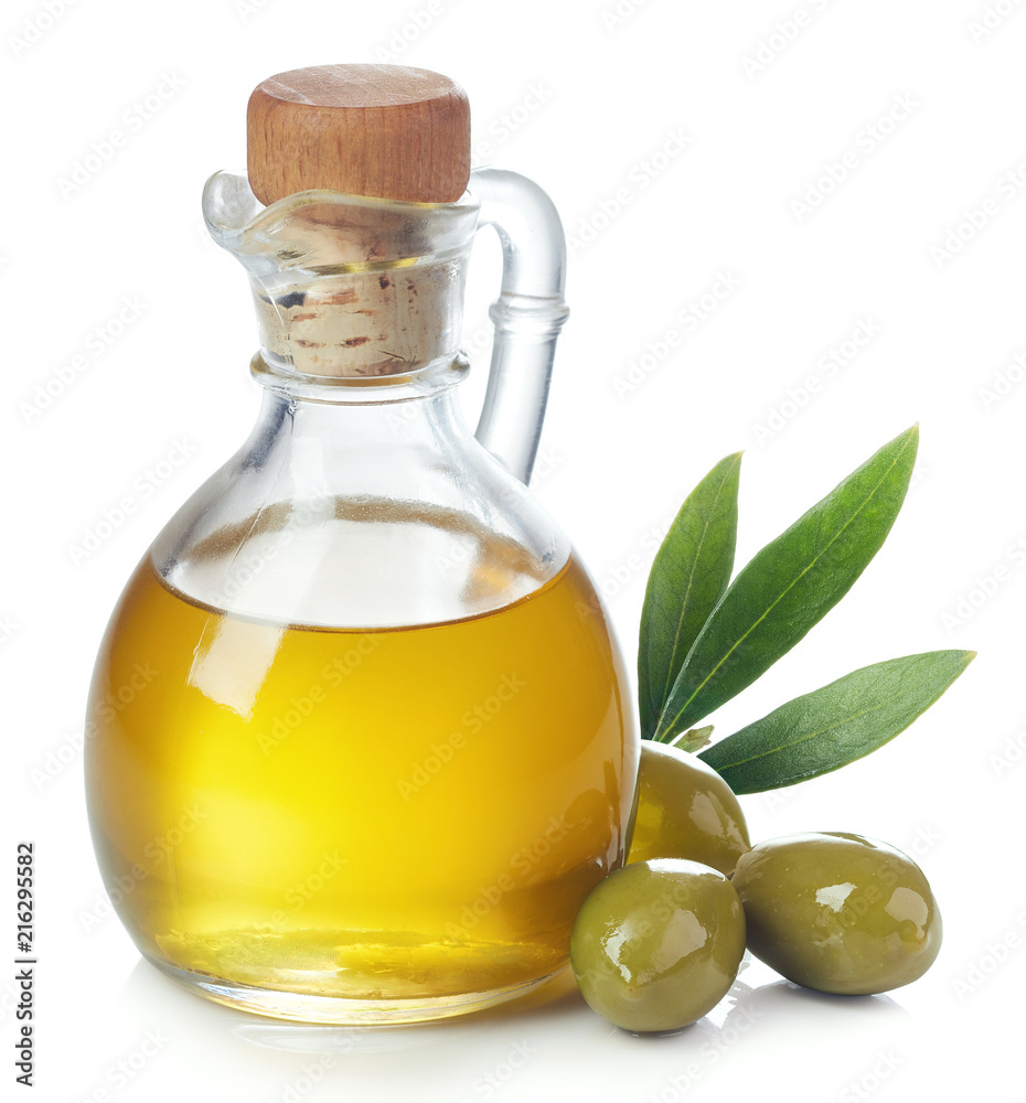 Fototapeta Bottle of olive oil and green olives with leaves