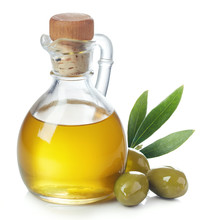Bottle Of Olive Oil And Green Olives With Leaves