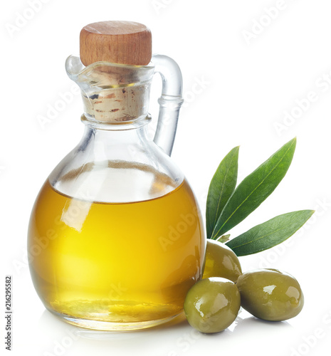 Fototapeta Bottle of olive oil and green olives with leaves obraz