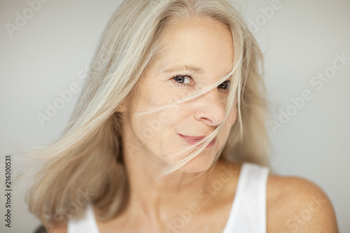 stunning beautiful and self confident best aged woman with grey hair smiling int Wallpaper Mural