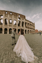 Young Wedding Couple By The Colosseum In Rome, Italy