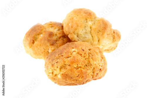 """Traditional bulgarian breakfast """"Dobrudzhanka"""" (from Dobrudzha region in Bulgaria). Three small bread like soda cakes with white flour and corn meal, eggs and cheese, isolated on white background"""