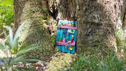 Decorated fairy door in a tree