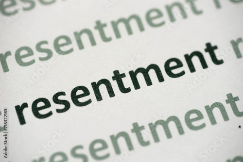 word resentment printed on paper macro Canvas Print