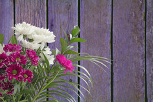 Bouquet Of Flowers With Space For Your Message - Lilac Brown Wooden Fence Panels Background With A Bunch Of Fresh Cut Flowers On Left Side And Space For A Message On Right
