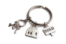 "Keychain With Mini Keys, House And Sign ""sold"", Isolated On White Background"