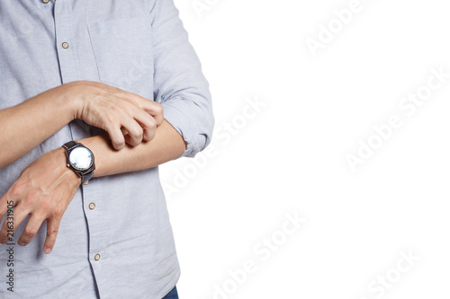 Man scratching his hand, isolated on white background - 216331905