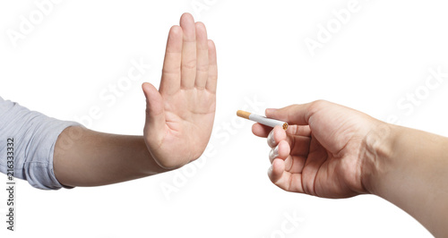 Fotografiet Hand refusing a cigarette offer, isolated on white background