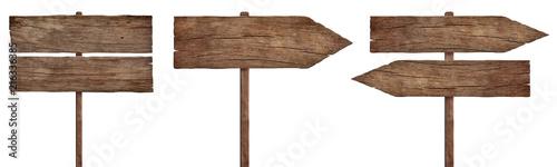 stare wyblakłe drewniane znaki, strzały i drogowskazy