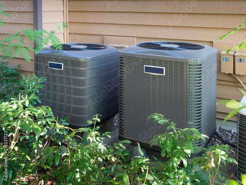 Air conditioning units outside a home Canvas Print
