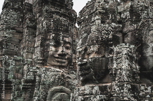 Foto op Plexiglas Asia land Faces of Bayon temple in Angkor Thom, The Bayon's most distinctive feature is the multitude of serene and smiling stone faces on the many towers