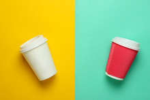 Two Paper Coffee Cup On A Colored Pastel Background, Top View, Minimalism..